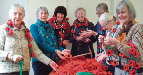 Ladies creating textile poppies