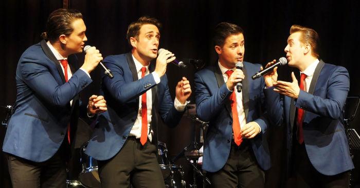 4 men on stage, East Coast Boys band